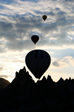 Silhouette of hot air balloon over sunset background