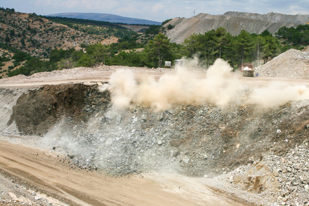 dragline: open cast mine after blast among dust and smoke