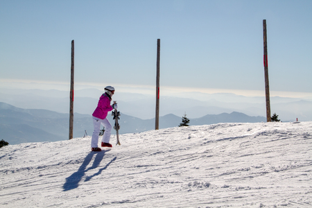 female skier at  the top of the mountain