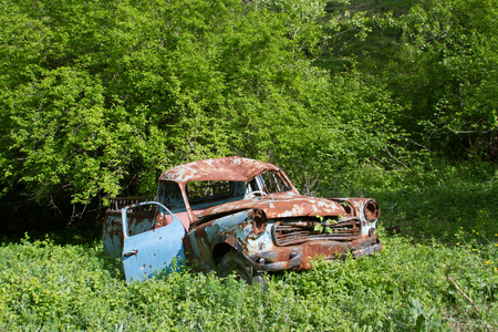 old rusty car at garden Stock Photo