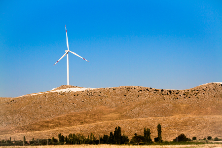 landscape with hills and wind turbine