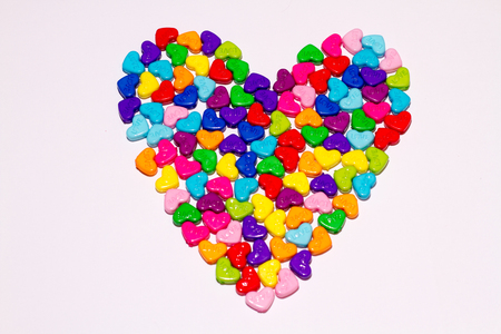 Heart shaped of multicolor painted sewing buttons