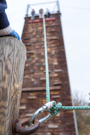 climbing wood wall at safety adventure park Stock Photo
