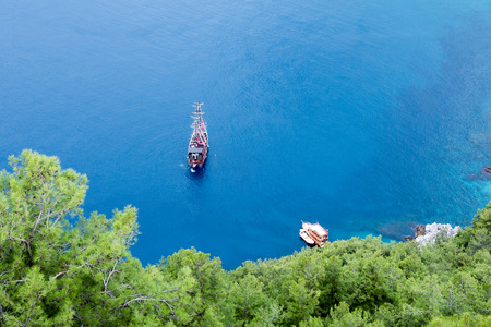 Boat on calm sea water near coast of Turkey