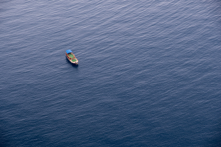 Boat on calm sea water near coast of Turkey