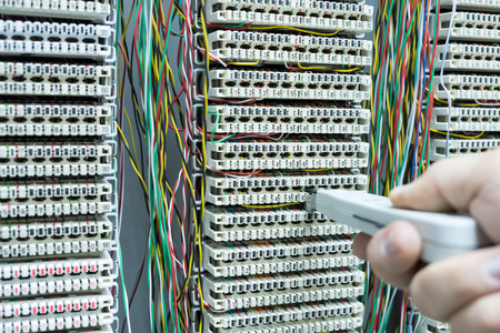 operator installing telephone switchboard  and internet