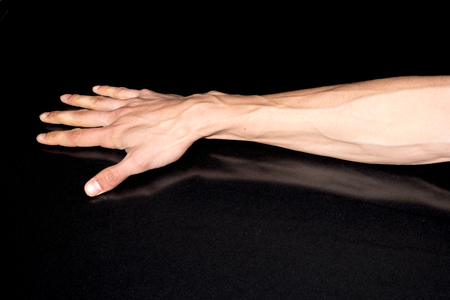 Man hand isolated on black background Stock Photo