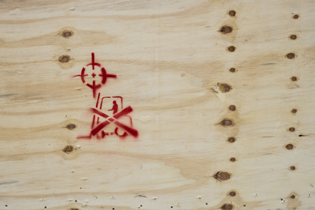 A wooden packing crate with various packing symbols Stock Photo