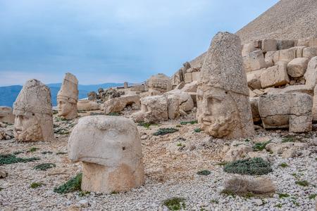 Nemrut Dagi, Anatolia, Turkey top the god Apollo  and ancient stone statues of the Goddess Tyche of Commagene ruins