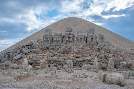 Nemrut Dagi, Anatolia, Turkey top the god Apollo  and ancient stone statues of the Goddess Tyche of Commagene ruins Stok Fotoğraf - 109737792