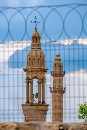 Minaret and bell tower  at Midyat, Mardin Turkey
