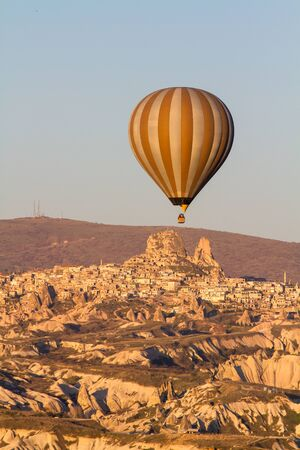 Hot air balloon flying over spectacular Cappadocia Stock fotó
