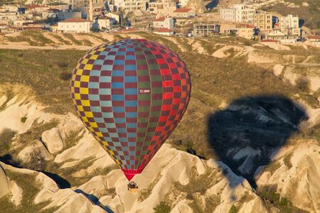 Hot air balloon flying over spectacular Cappadocia Stock Photo