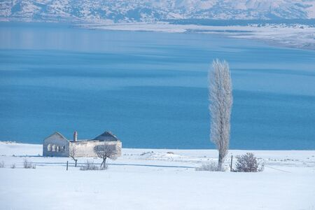Winter Landcape with lake and village