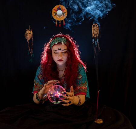 Fortune Telling lady in dark room