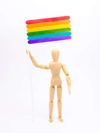 wooden human holding lgbt flag