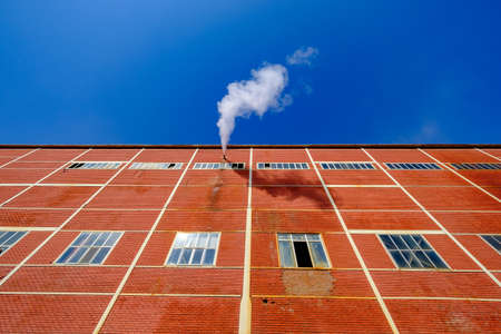 factory with old brick wall and pipe