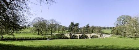 chatsworth: Parkland abording the river at Chatsworth House, Peak District, England. Stock Photo