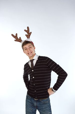 Young man posing and wearing deers horns photo
