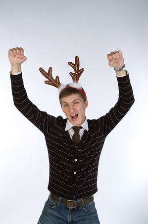 Young man wearing deers horns happy for his success photo