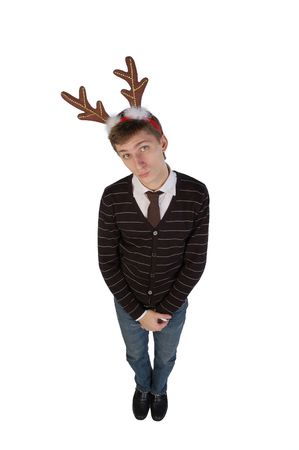 modest: Shy young man wearing deers horns. High angle view. Isolated.