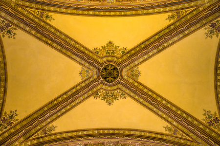 Detail of ornamental decorations in ceiling of interior passage in italian palazzo style building Stock Photo