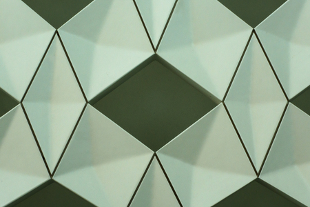 Close-up detail of modern interior wall design with geometric shapes and lines forming pattern.
