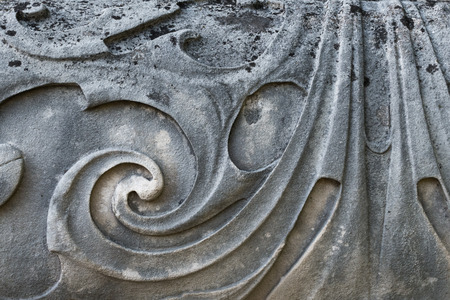 Close-up detail of rendered patterns on Baroque period gatepost