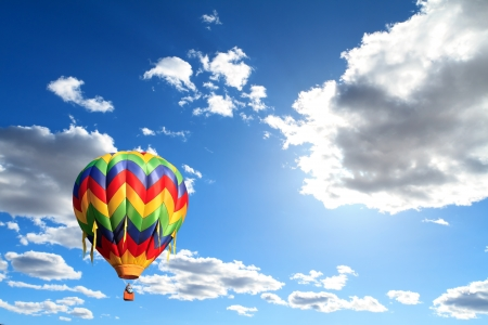 air: hot air balloon over cloudy sky