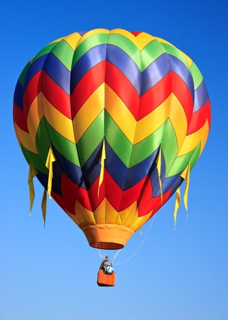 air: colorful hot air balloon on blue sky