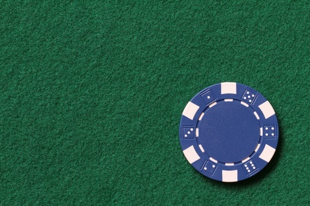 blue poker chip on a table with text space photo