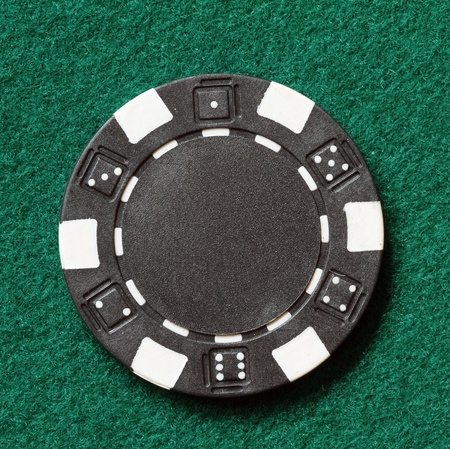 black poker chip on a table