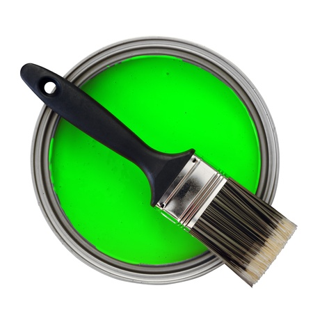 green paint with paint brush over white background photo