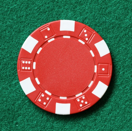 poker table: red poker chip on a table  Stock Photo