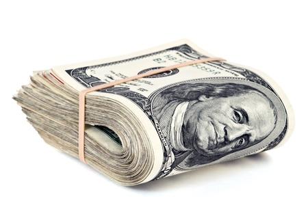 dolar: billetes de cien d�lares doblados aislados en blanco Foto de archivo