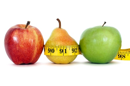 losing weight: fruits with measure tape over white background, clipping path Stock Photo
