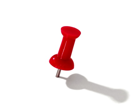 red thumbtack over white background  photo