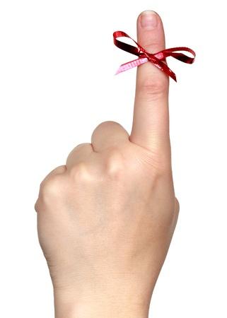gefesselt: Finger mit roter Schleife