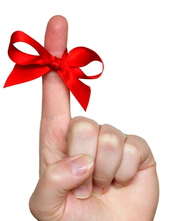 vinger met rode strik Stockfoto