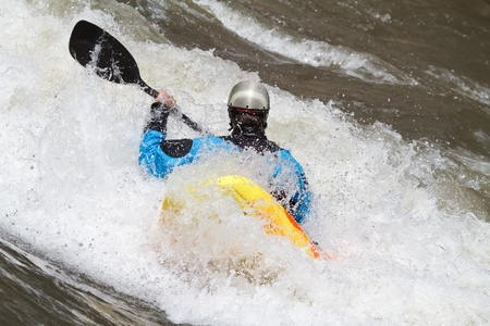 man in kayak, freestyle competition