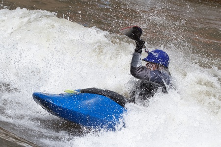 whitewater: man in kayak, freestyle competition