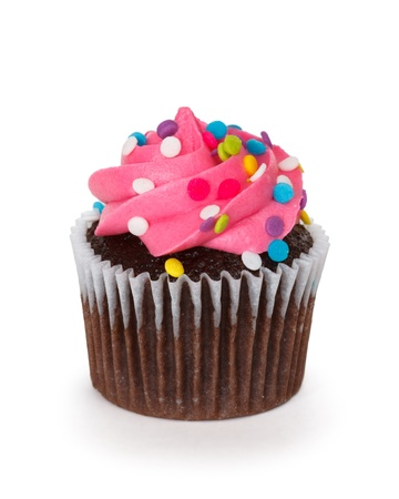 decorating: cupcake over white background