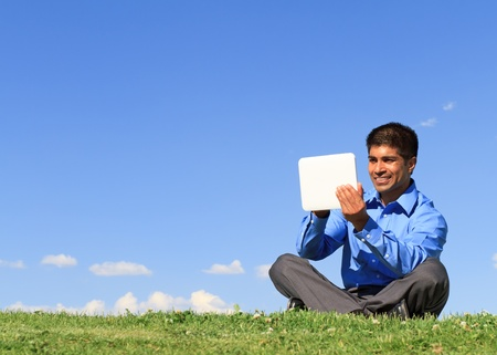 young businessman at the park working with tablet  Stock Photo - 13366743