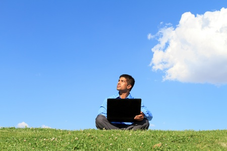 businessman with laptop looking up photo