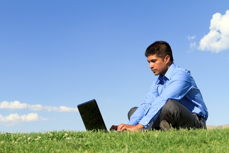 young businessman working at the park  Foto de archivo