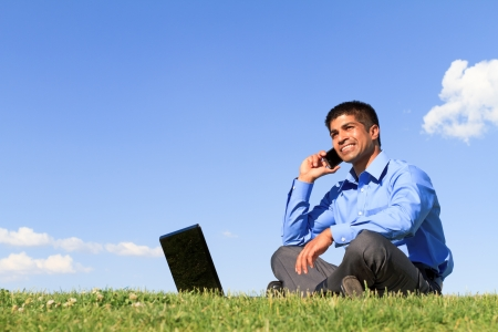 talking businessman: young businessman working at the park  Stock Photo