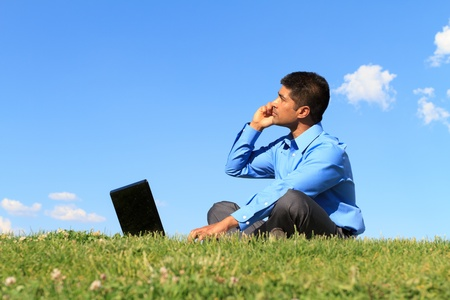 young businessman working at the park  photo