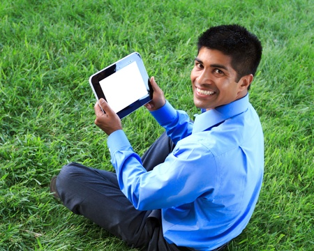 young businessman at the park working with tablet Stock Photo - 13366818