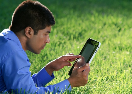 businessman at the park with tablet  photo