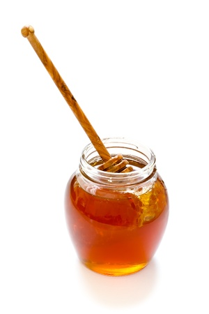 jar of honey with dipper Stock Photo - 13328745